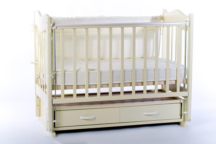 кроватка-маятник с ящиками