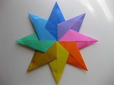 Как сделать из бумаги летающую звезду фото 378
